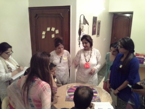 Neera Sareen explaining Angel Readings through Angel Oracle Board to her students