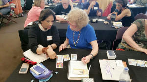 Neera-Sareen-teaching-advanced tarot-reading-(Specialisation in Tarot Reading)to-one-of-the-participant-in-world-tarot-summit-in-New-York-2016